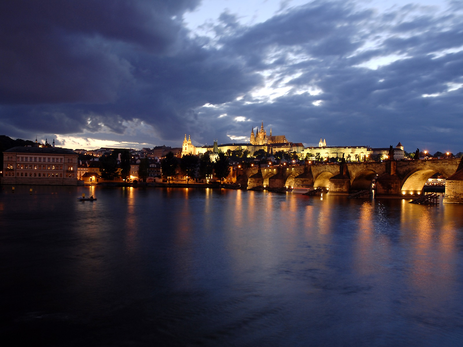 Prague Castle panorama with Charles Bridge in the evening